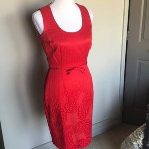 Ruby Red Dress with pattern around hem and bottom